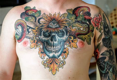 triple crown tattoo healed chest by joey ortega at crown