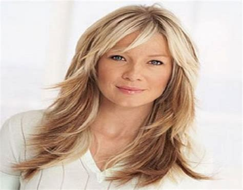 flattering haristyles for women over 50 with loger hair medium hairstyles with bangs for women over 50
