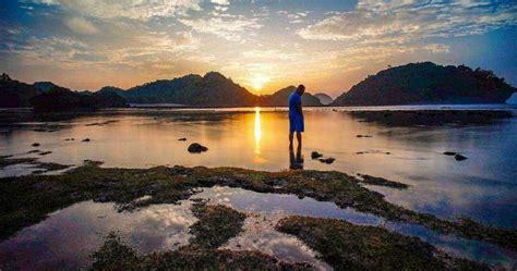 travel juanda pantai teluk asmara malang terbaik  aman