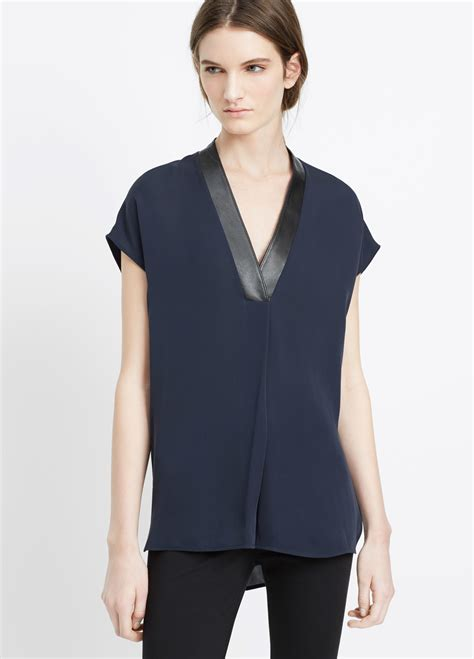 Hering Blue Leather Trim Blouse lyst vince silk cap sleeve v neck top with leather trim