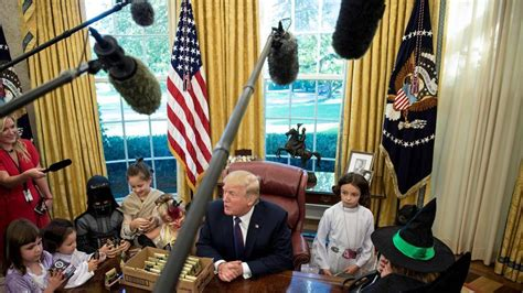 trump hosts white house reporters kids for oval office witches batgirl and darth vader storm white house as