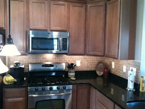 Which Color Subway Tile For Maple Cabinets And Granite - toffee cabinets black granite brick tile