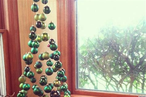 a christmas tree made of suspended ornaments as seen on