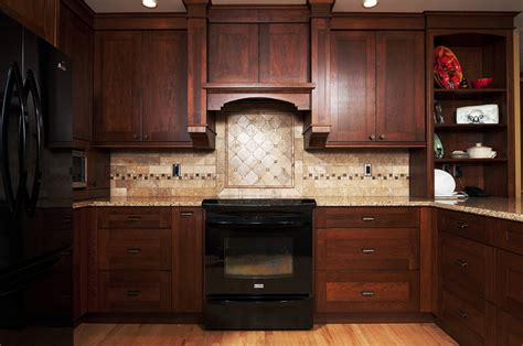 kitchen backsplash with oak cabinets and black appliances cherry cabinets with black appliances