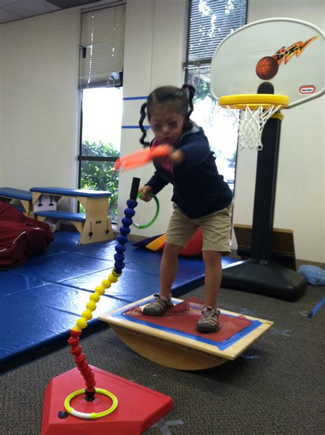 physical therapy balance mat using a balance board starfish therapies