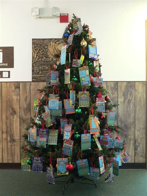 christmas tree decorated with lottery tickets books for