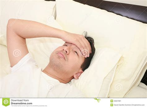 lying or laying in bed young man lying down in bed stock image image 23227961