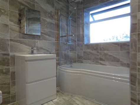 shower bath coventry bathrooms 187 p shaped shower bath bathroom mirror and grey bathroom tiles
