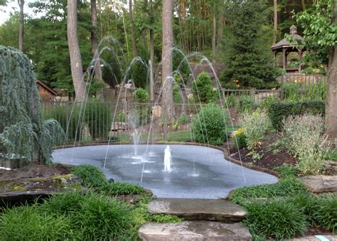 splash pads a modern twist on backyard water features
