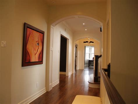 house of passage arched paneled passage way custom built in cabinetry coffered ceiling