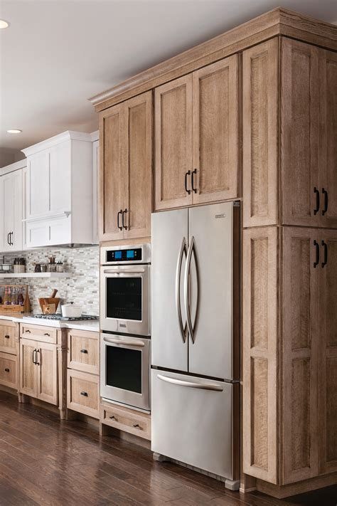 schuler kitchen cabinets schuler cabinetry launches new cappuccino finish laundry