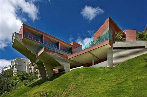Houses Built On Slopes | sculptural concrete house built on a steep slope modern