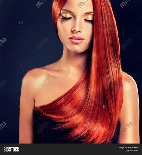 beautiful model with elegant hairstyle stock photo beautiful girl model with long straight shiny red hair