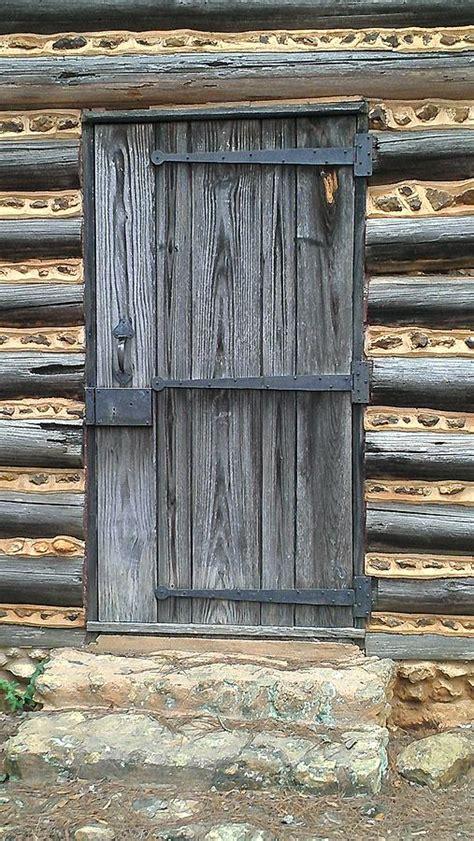 log cabin door photograph by lew davis