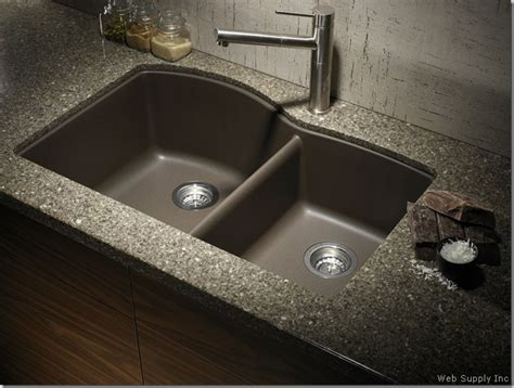 tropic brown granite with black silgranit sink kitchen the granite gurus faq friday does the kitchen sink need