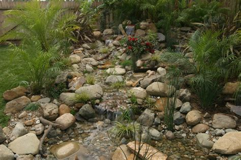 aquascape design melbourne disappearing backyard pondless waterfalls fl melbourne