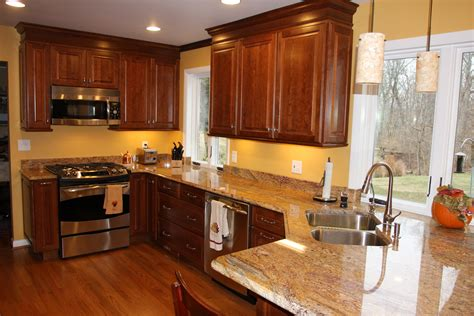 granite with cherry cabinets in kitchens brown cherry wood kitchen cabinet with brown granite countertop on laminate flooring plus white