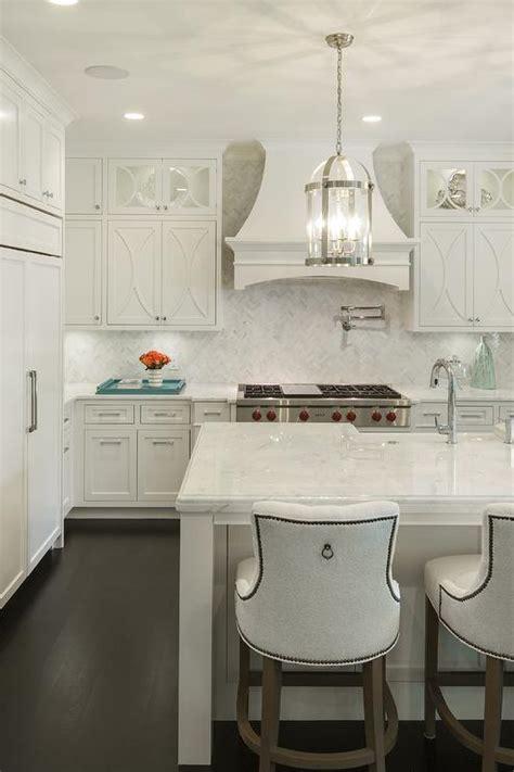 white kitchen  french range hood transitional