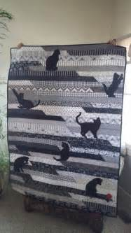 jelly roll race quilt look what a bit of cat applique can