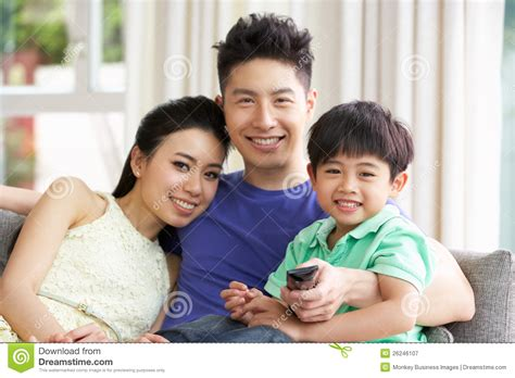 Van Sofa Bed Chinese Family Watching Tv On Sofa Together Royalty Free