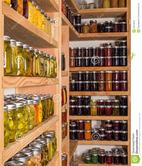 storage shelves with canned food royalty free stock photos