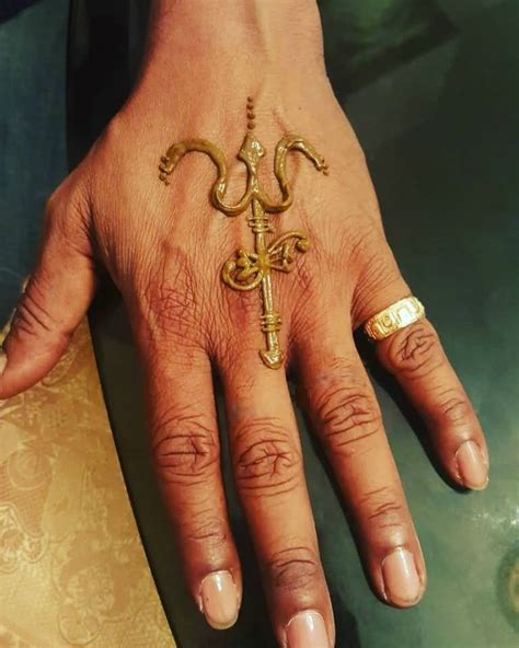 tattoo hand back heena style trishul tattoo on back hand with pellet drum