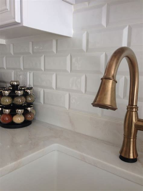 champagne bronze delta cassidy faucet cobsa white bevel tile backsplash kitchen pinterest