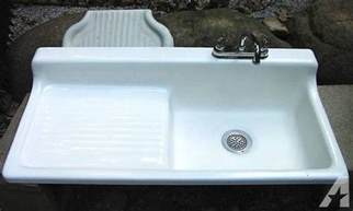 original cast iron farmhouse kitchen sink with drainboard