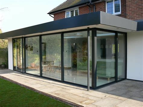 Glass patio enclosure; flat roof   House   Patio