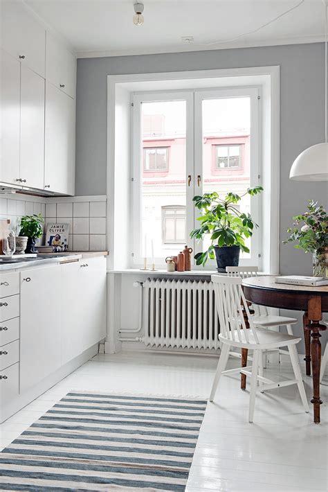 Off The Shelf Kitchen Cabinets by Stylish Swedish Studio Apartment Lives Large