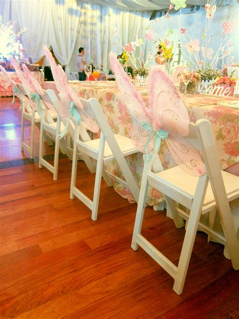 themed kiddies party decor reserv s white folding chairs at a fairy garden themed