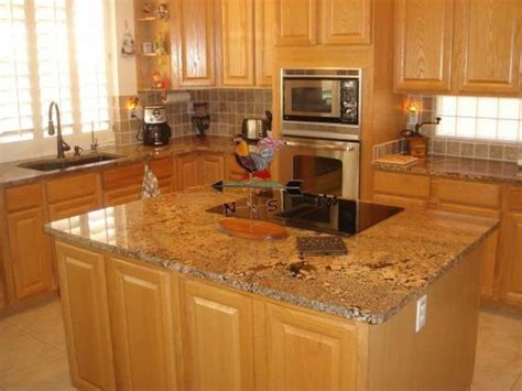 granite countertops with light cabinets this color granite works with oak cabinets and light