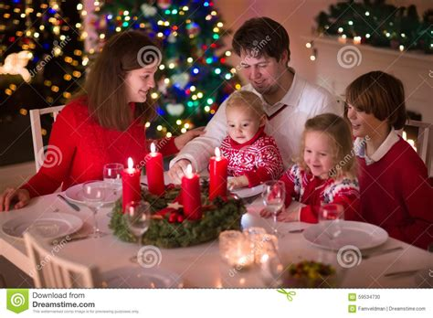 tree at home family enjoying dinner at home stock photo