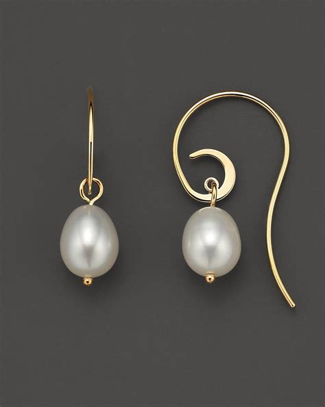 Bonia 8206 Silver freshwater pearl swirl wire earrings 10 x 8 mm