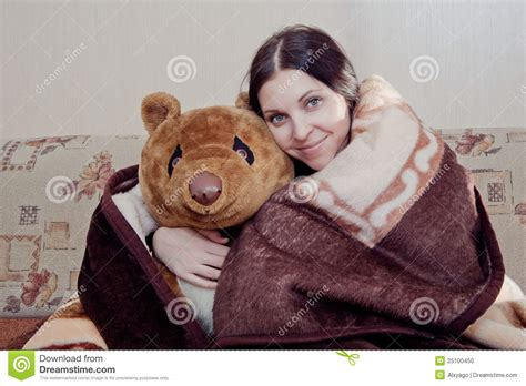 horse sitting on couch woman with teddy bear stock photo image 25100450