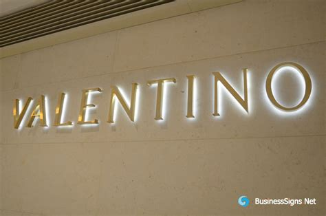 Acrylic Di Batam 3d led backlit signs with brushed gold plated letter shell for valentino gallery businesssigns net