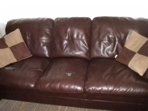 pillows on brown leather couch brown leather sofa two decorative pillows nepean ottawa
