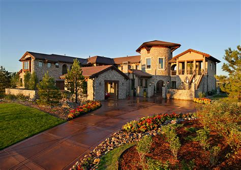 the tuscan house mediterranean style stone leading denver residential