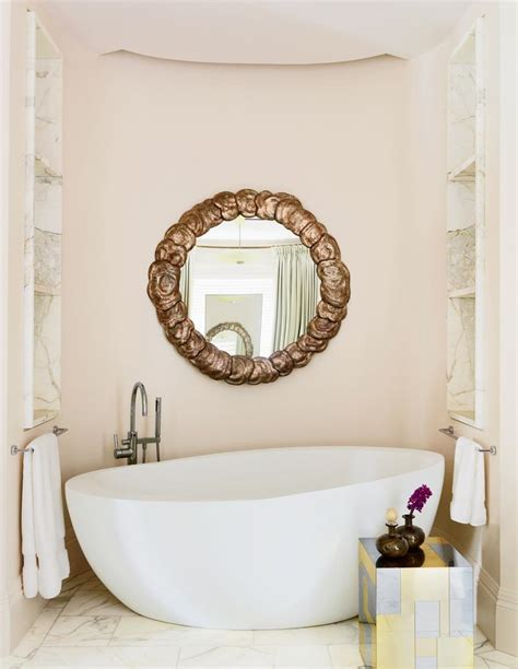 pale pink coastal paint colors for bathroom with white bathtub and deco mirror artenzo