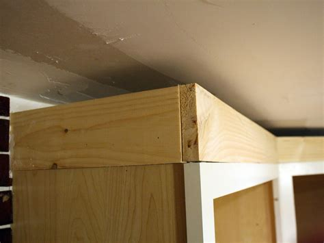 how to install crown molding on top of kitchen cabinets how to install cabinet crown molding how tos diy