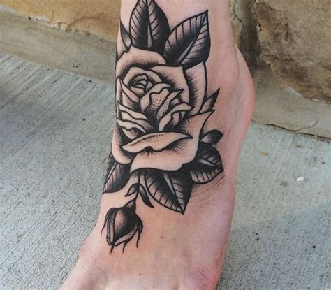 foot rose tattoo traditional style black and grey on foot