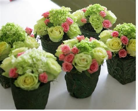 small centerpiece ideas green flowers with miniature pink roses