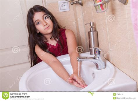 girls changing dress in bathroom one beautiful little middle eastern arab girl with red