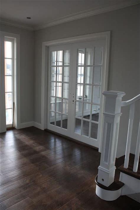 light grey room i love contrast the dark floors with the light grey walls