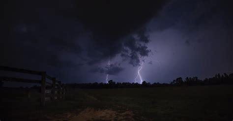 lightning strike  ground  night time  stock