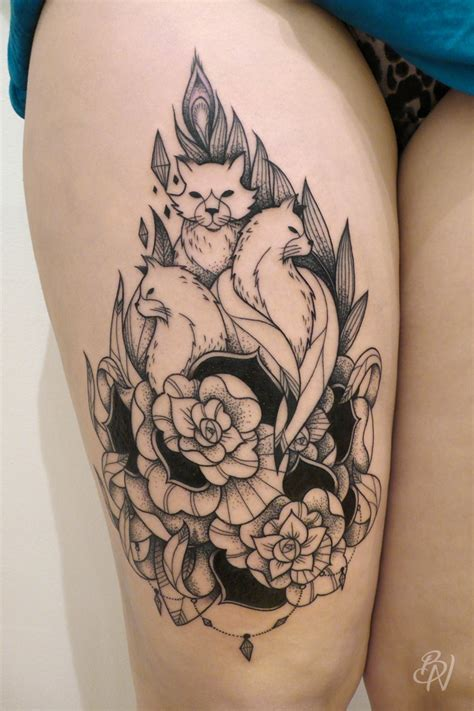 engraving tattoo engraving style black ink thigh of foxes with