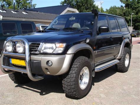 nissan safari lifted nissan patrol y61 with safari snorkel procomp x terrain