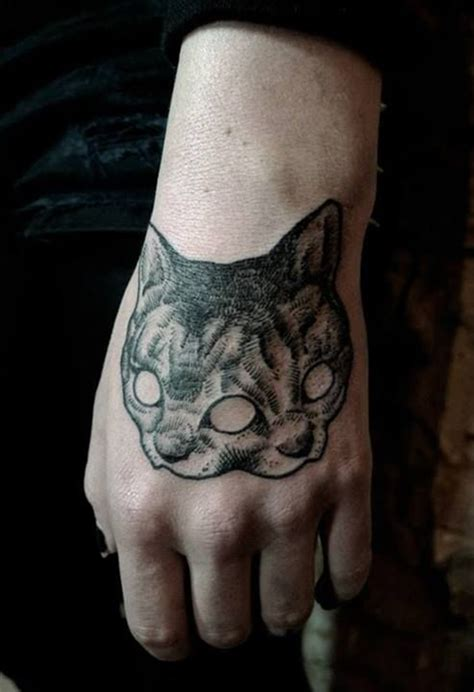cat tattoo in hand bold hand tattoo ideas best tattoos for 2018 ideas