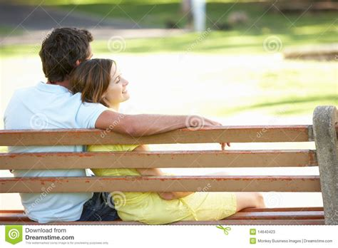 sitting park bench couple sitting together on park bench stock photos image 14640423
