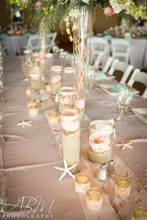 themed wedding centerpieces garden roses on top of sand and crushed seashells julena